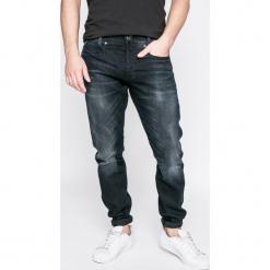 G-Star Raw - Jeansy D-Staq. Niebieskie jeansy męskie regular G-Star RAW. W wyprzedaży za 359,90 zł.