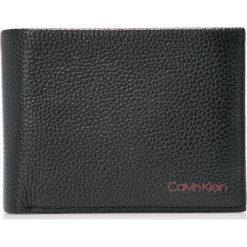 Calvin Klein - Portfel skórzany. Czarne portfele męskie Calvin Klein, z materiału. W wyprzedaży za 259,90 zł.