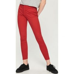 Rurki damskie: Spodnie skinny z zamkami - Pomarańczo