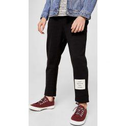 Mango Kids - Spodnie dziecięce Flips 110-164 cm. Szare spodnie chłopięce marki Mango Kids, z bawełny. W wyprzedaży za 49,90 zł.