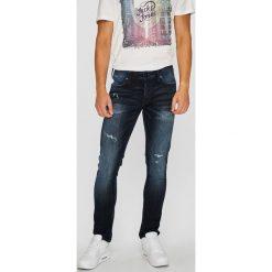 Jack & Jones - Jeansy Glenn. Czarne jeansy męskie relaxed fit marki Jack & Jones, l, z bawełny, z klasycznym kołnierzykiem, z długim rękawem. Za 219,90 zł.