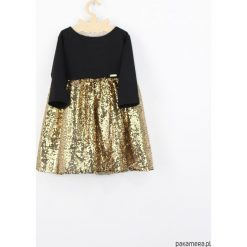 Sukienka złota z cekinami. Żółte sukienki dziewczęce z falbanami Pakamera, z jersey. Za 139,00 zł.