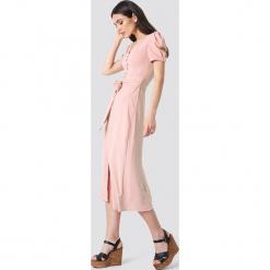Trendyol Sukienka midi z guzikami - Pink. Szare sukienki na komunię marki Trendyol, na co dzień, z elastanu, casualowe, midi, dopasowane. Za 161,95 zł.