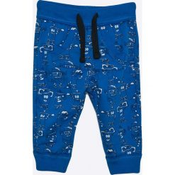 Blukids - Spodnie dziecięce 68-98 cm. Niebieskie spodnie chłopięce Blukids, z bawełny. W wyprzedaży za 24,90 zł.