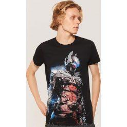 Koszulka piżamowa Batman - Czarny. Czarne piżamy męskie marki KIPSTA, z poliesteru, do piłki nożnej. Za 49,99 zł.