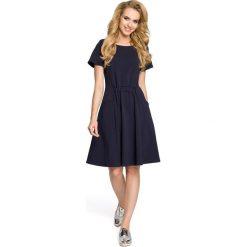 NICOLE Sukienka z kieszeniami i gumką w talii - granatowa. Niebieskie sukienki Moe, do pracy, s, z bawełny, biznesowe. Za 139,99 zł.