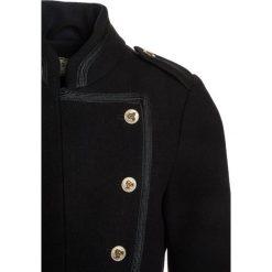Scotch R'Belle BELLBOY Kurtka przejściowa navy. Niebieskie kurtki chłopięce przejściowe marki Scotch R'Belle, z materiału. W wyprzedaży za 486,75 zł.