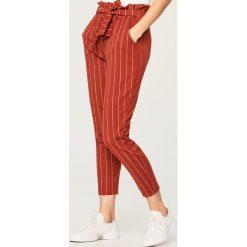 Spodnie z wysokim stanem - Czerwony. Czarne spodnie z wysokim stanem marki DOMYOS, z bawełny. Za 89,99 zł.