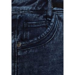 Tumble 'n dry ADONI Szorty jeansowe denim medium used. Niebieskie spodenki chłopięce marki Tumble 'n dry, z bawełny. W wyprzedaży za 132,30 zł.