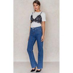 NA-KD Jeansy z prostą nogawką i wysokim stanem - Blue. Niebieskie jeansy damskie NA-KD, z bawełny. W wyprzedaży za 91,98 zł.