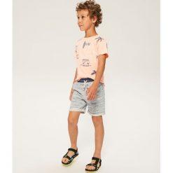 Szorty dresowe - Niebieski. Czarne dresy chłopięce marki bonprix, w paski, z dresówki. W wyprzedaży za 39,99 zł.