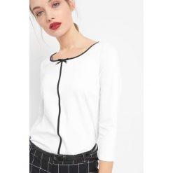 Koszulka z kontrastową lamówką. Brązowe t-shirty damskie marki Orsay, s, z dzianiny. Za 69,99 zł.