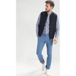 Chinosy męskie: DOCKERS ALPHA Spodnie materiałowe sunset blue