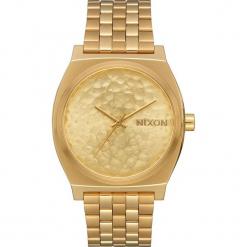 """Zegarek """"Time Teller"""" w kolorze złotym. Żółte, analogowe zegarki męskie Nixon, ze stali. W wyprzedaży za 159,95 zł."""
