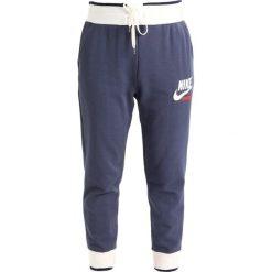 Spodnie dresowe damskie: Nike Sportswear PANT ARCHIVE Spodnie treningowe thunder blue