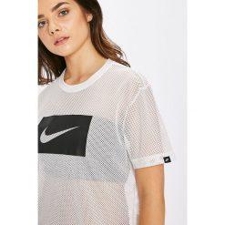 Nike Sportswear - T-shirt. Różowe t-shirty damskie marki Nike Sportswear, l, z nylonu, z okrągłym kołnierzem. W wyprzedaży za 99,90 zł.