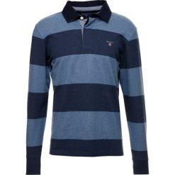 GANT THE ORIGINAL BARSTRIPE HEAVY RUGGER Koszulka polo denim blue melange. Niebieskie koszulki polo marki GANT, m, z bawełny, z długim rękawem. Za 419,00 zł.