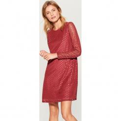 Sukienka z połyskującą aplikacją - Brązowy. Pomarańczowe sukienki z falbanami marki numoco, l, w kwiaty, z dekoltem w łódkę, oversize. Za 99,99 zł.