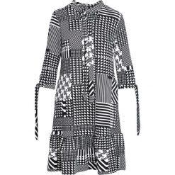 Czarna Sukienka Engross. Czarne sukienki Born2be, l, midi, oversize. Za 59,99 zł.