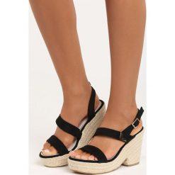 Czarne Sandały Sheets. Czarne sandały damskie marki Born2be, z materiału, na koturnie. Za 24,99 zł.