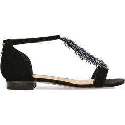 Sandały SALY. Czarne sandały damskie marki Gino Rossi, ze skóry, na płaskiej podeszwie. Za 229,90 zł.