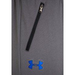 Under Armour PENNANT Spodnie treningowe graphite. Szare spodnie chłopięce marki Under Armour, z materiału. W wyprzedaży za 126,75 zł.