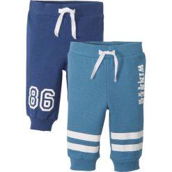 Jeansy męskie regular: Spodnie dresowe niemowlęce (2 pary), bawełna organiczna bonprix niebieski dżins - kobaltowy