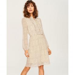Sukienka z żabotem - Wielobarwn. Szare sukienki z falbanami marki Reserved, z żabotem. Za 139,99 zł.