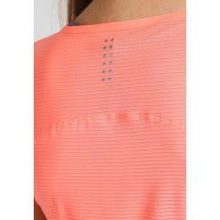 Puma SPEED  Tshirt basic energy peach. Brązowe topy sportowe damskie marki Puma, xs, z elastanu. W wyprzedaży za 151,20 zł.