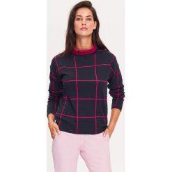 Sweter w kolorze granatowym. Niebieskie swetry klasyczne damskie marki TATUUM, m, ze stójką. W wyprzedaży za 154,95 zł.