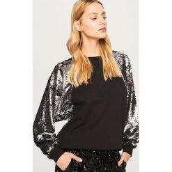 Bluza z cekinowymi rękawami - Czarny. Czarne bluzy damskie Reserved, l. Za 139,99 zł.