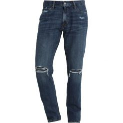 Abercrombie & Fitch DISTRESSED Jeansy Slim Fit medium destroy. Niebieskie jeansy męskie Abercrombie & Fitch. Za 369,00 zł.