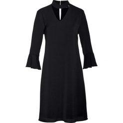Sukienka z falbanami bonprix czarny. Czarne sukienki na komunię marki bonprix. Za 79,99 zł.