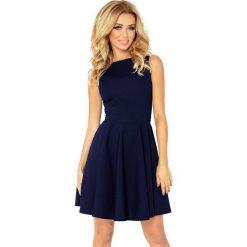 125-21 sukienka koło - dekolt łódka - cegiełka granatowa. Niebieskie sukienki marki numoco, l, z dekoltem w łódkę, oversize. Za 131,00 zł.