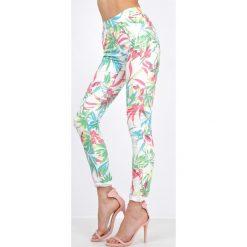 Rurki damskie: Jasne spodnie rurki ze wzorem jungle