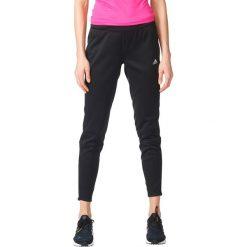 Spodnie sportowe damskie: Adidas Spodnie Response Warm Astro czarne r. L (AX6603)