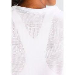 Nike Performance DRY SLAM Tshirt basic white. Białe topy sportowe damskie marki Nike Performance, m, z materiału. W wyprzedaży za 167,30 zł.