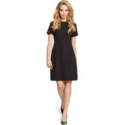 SYDNEE Sukienka trapezowa z kontrafałdą na plecach - czarna. Czarne sukienki na komunię Moe, do pracy, s, biznesowe, z dekoltem na plecach, dopasowane. Za 119,00 zł.
