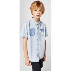 Mango Kids - Koszula dziecięca Mario 110-164 cm. Szare koszule chłopięce z krótkim rękawem marki Mango Kids, z bawełny, z klasycznym kołnierzykiem. W wyprzedaży za 39,90 zł.