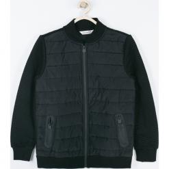 Bluza. Czarne bluzy chłopięce rozpinane TRAVELLER, z długim rękawem, długie. Za 119,90 zł.