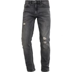 Spodnie męskie: Calvin Klein Jeans CAVERN DESTRUCTED Jeansy Slim Fit denim