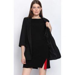 Czarna Sukienka Love More. Czarne sukienki hiszpanki Born2be, l, mini, oversize. Za 49,99 zł.