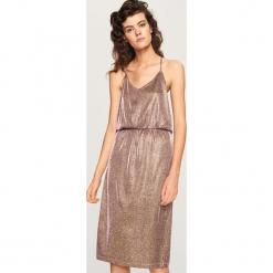 Błyszcząca sukienka - Złoty. Żółte sukienki marki Reserved, l. Za 119,99 zł.