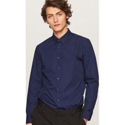 Elegancka koszula z tkaniny poplin - Granatowy. Niebieskie koszule męskie marki QUECHUA, m, z elastanu. Za 79,99 zł.