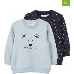 Bluzy (2 szt.) w kolorze błękitnym i granatowym. Niebieskie bluzy chłopięce rozpinane Name it Baby, z haftami, z bawełny. W wyprzedaży za 42,95 zł.