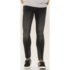 Jeansy skinny - Czarny. Czarne jeansy męskie regular House, z jeansu. Za 99,99 zł.