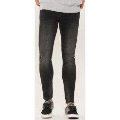 Jeansy skinny - Czarny. Czarne jeansy męskie skinny House. Za 99,99 zł.
