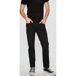 Armani Exchange - Spodnie. Czarne rurki męskie marki Armani Exchange, l, z materiału, z kapturem. W wyprzedaży za 399,90 zł.