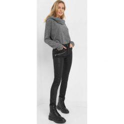 Spodnie z zamkami. Czarne rurki damskie marki Orsay, xs, z bawełny, z dekoltem na plecach. Za 129,99 zł.