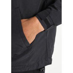 HUF STANDARD Kurtka wiosenna black. Czarne kurtki męskie marki HUF, z gumy. Za 379,00 zł.